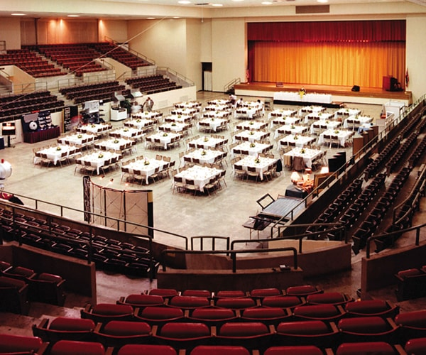 Large Civic Center with many tables and chairs set up